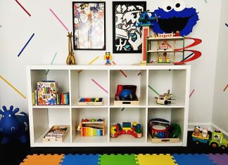 a playroom toy shelf with toys easily displayed, per the Montessori method