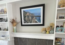 a fireplace with painted gray tile and white grout