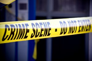 a close up of a building surrounded with yellow crime scene tape