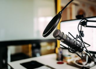 a studio with a microphone set up for a podcast