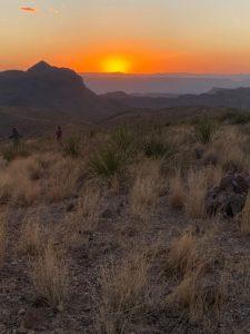 the sun setting over the desert