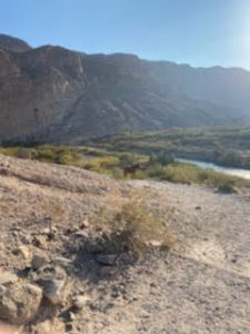 a spot in Big Bend National Park where the desert terrain meets up with a river by a mountain range