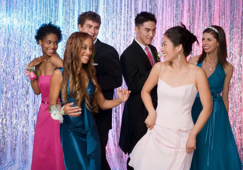 a group of high schoolers dancing at prom