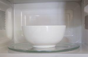 a ceramic bowl in a microwave