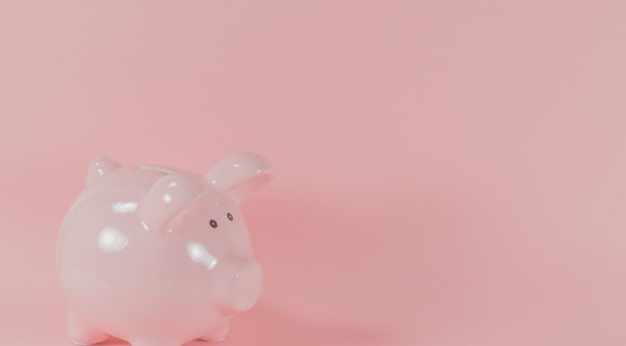 a pink piggy bank symbolizing financial independence