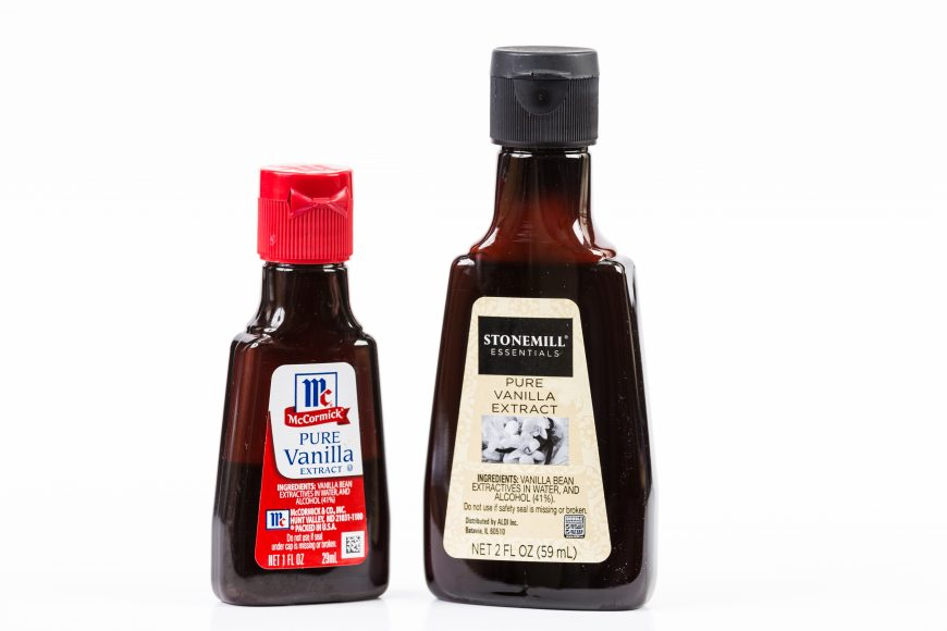 two bottles of vanilla extract on a white background