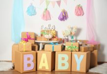 baby gifts on a table with baby shower decorations