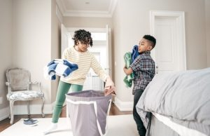 letting kids help as they put laundry from the basket away