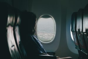 a woman on an empty plane sitting by the window