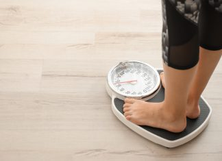 feet on a scale to gauge weight