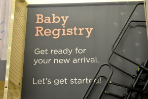 A baby registry sign at a store