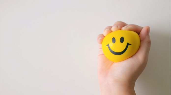 a yellow stress ball with a smiley face