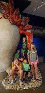 kids posing by a crab statue at the St. Louis City Museum