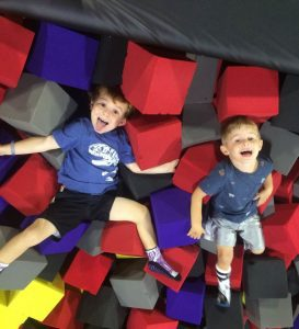 two toddler boys playing in a foam pit at Defy in Ballwin, MO