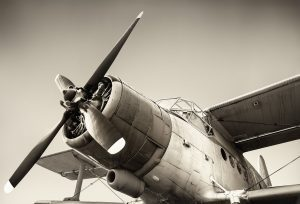 a black and white photo of an antique airplane