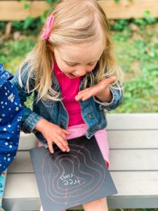 a toddler girl playing outdoors