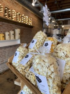 a photo of bags of popcorn on a shelf at Pop Culture in Overland Park in Kansas City