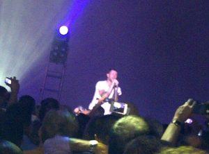 Adam Levine singing at a private concert