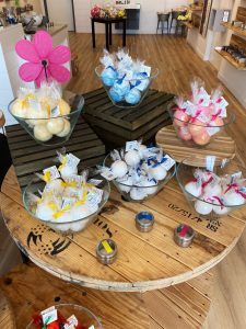 bowls of soap displayed on wooden crates on a table at a soap shop in Edwardsville, IL
