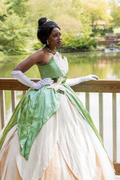 A woman dressed as Tiana for St. Louis Mom's Hanging with Heroes event