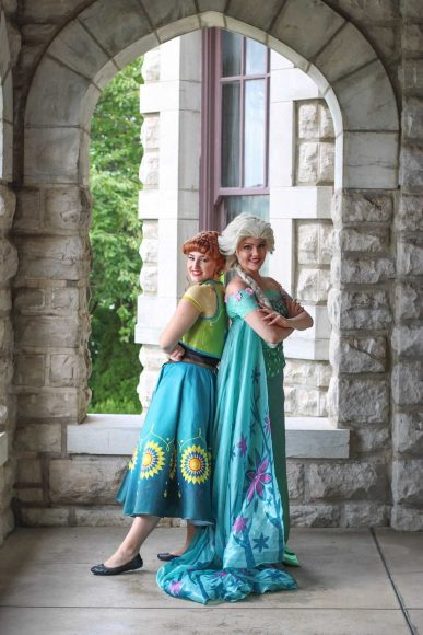 Characters dressed as Anna and Elsa from Frozen for St. Louis Mom's Hanging with Heroes event