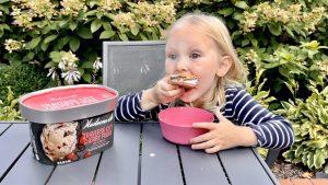 Girl eating Hudsonville Ice Cream Store