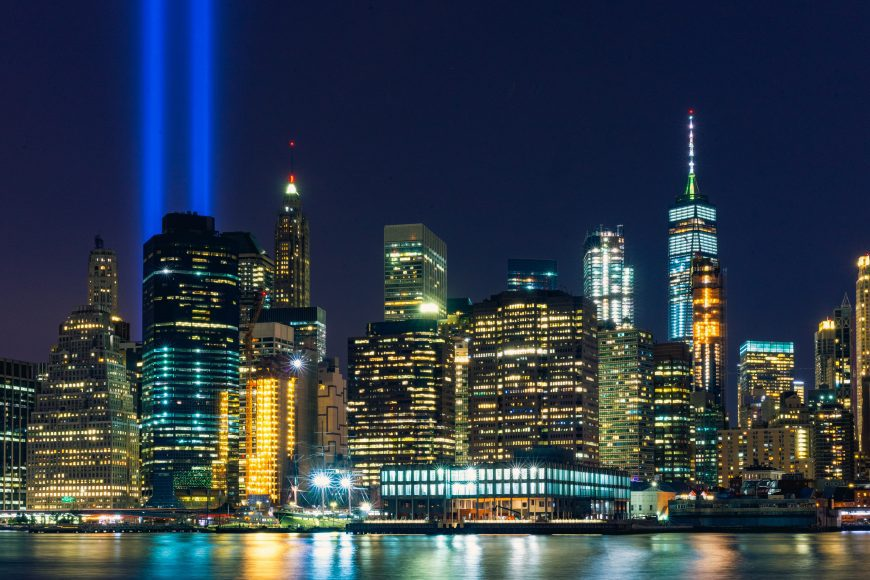 The New York skyline with bright lights shining in place of the Twin Towers