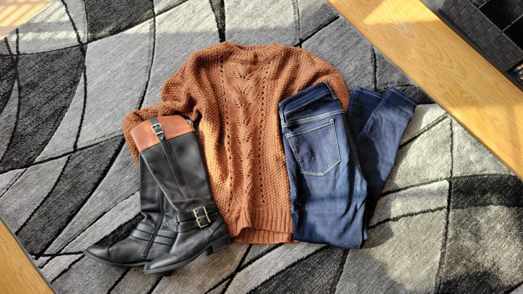 Leather boots, a chunky sweater, and dark wash jeans for fall