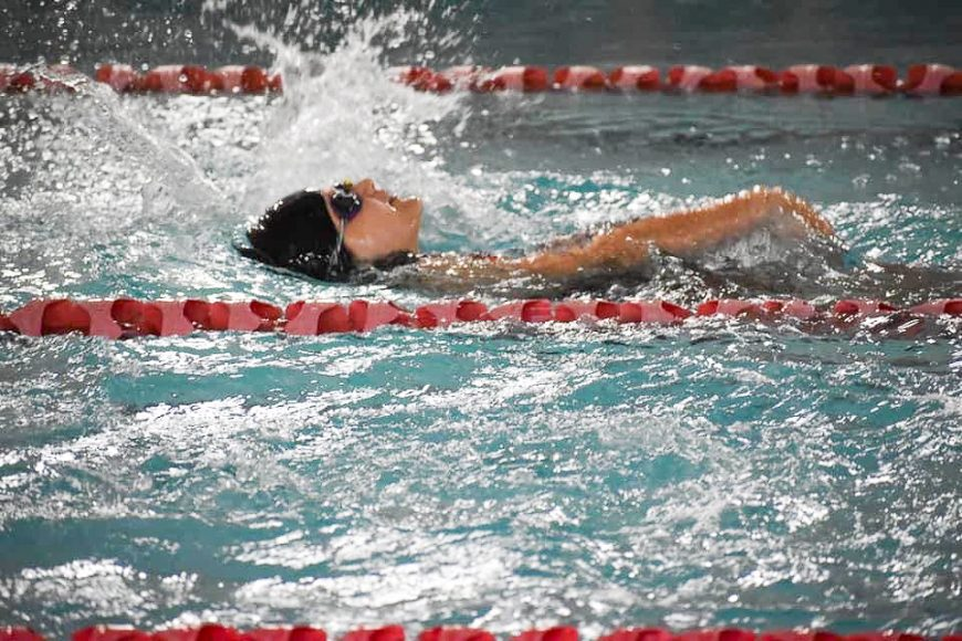 a girl swimming in a race
