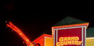 a picture of The Grand Country Fun Spot in Branson, Missouri all lit up at night