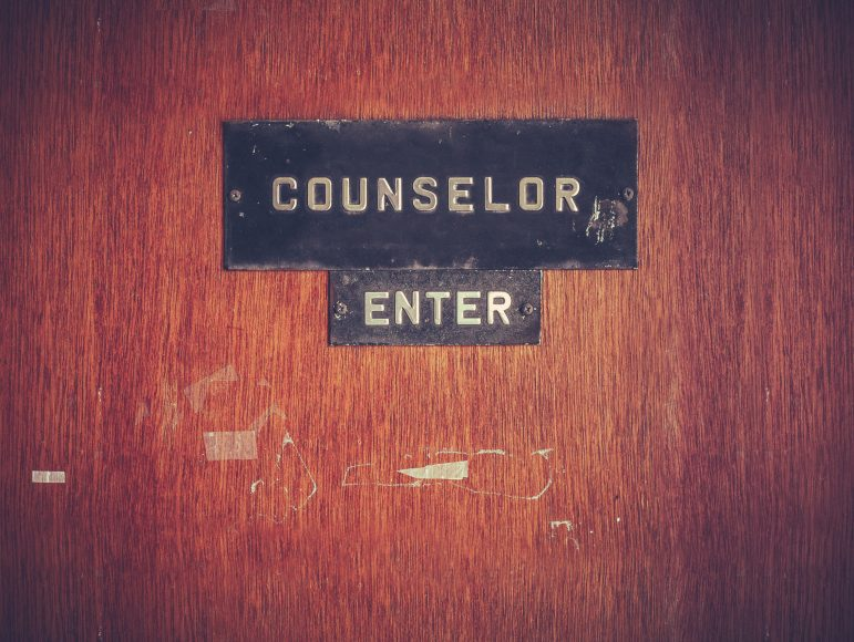 a wooden door with a sign saying, Counselor Enter
