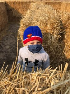 Josh in the hay bales at Heritage Farms