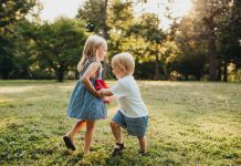 Two Kids Playing Outdoors